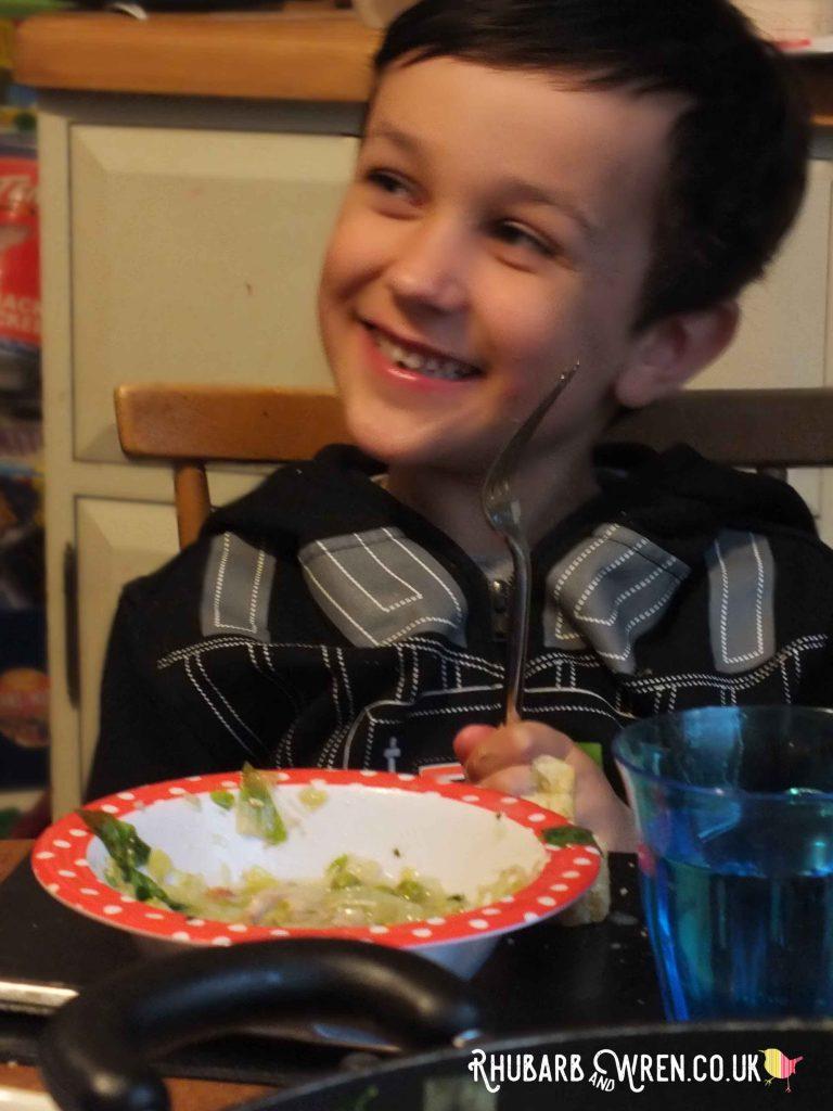 boy enjoying Nigella's spring chicken
