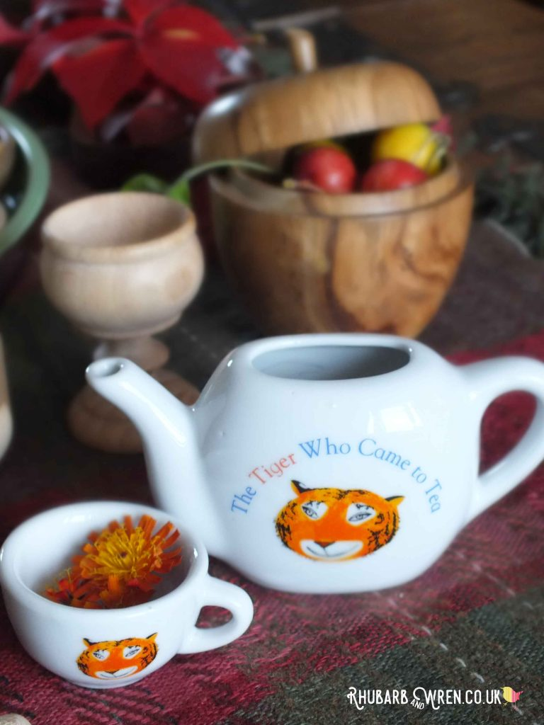 Pretend tea made from flowers in a tiger teapot