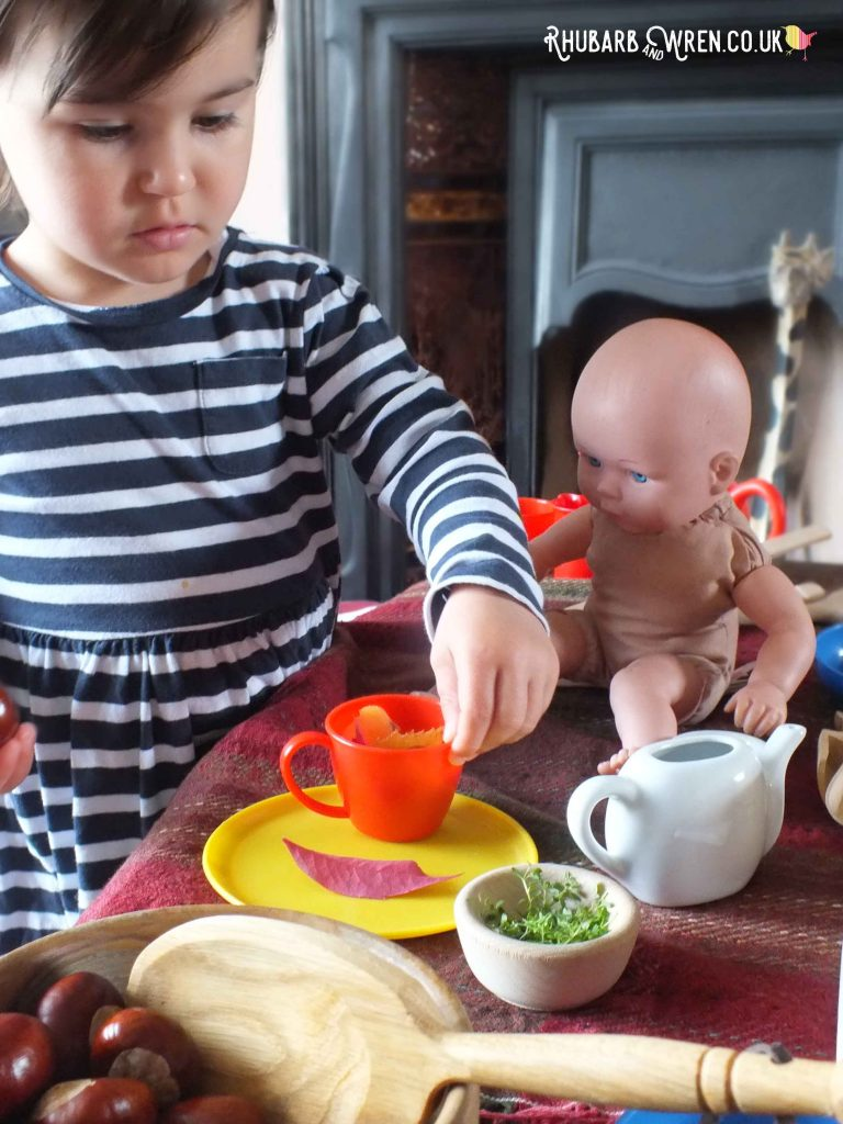 toddler having doll's tea party