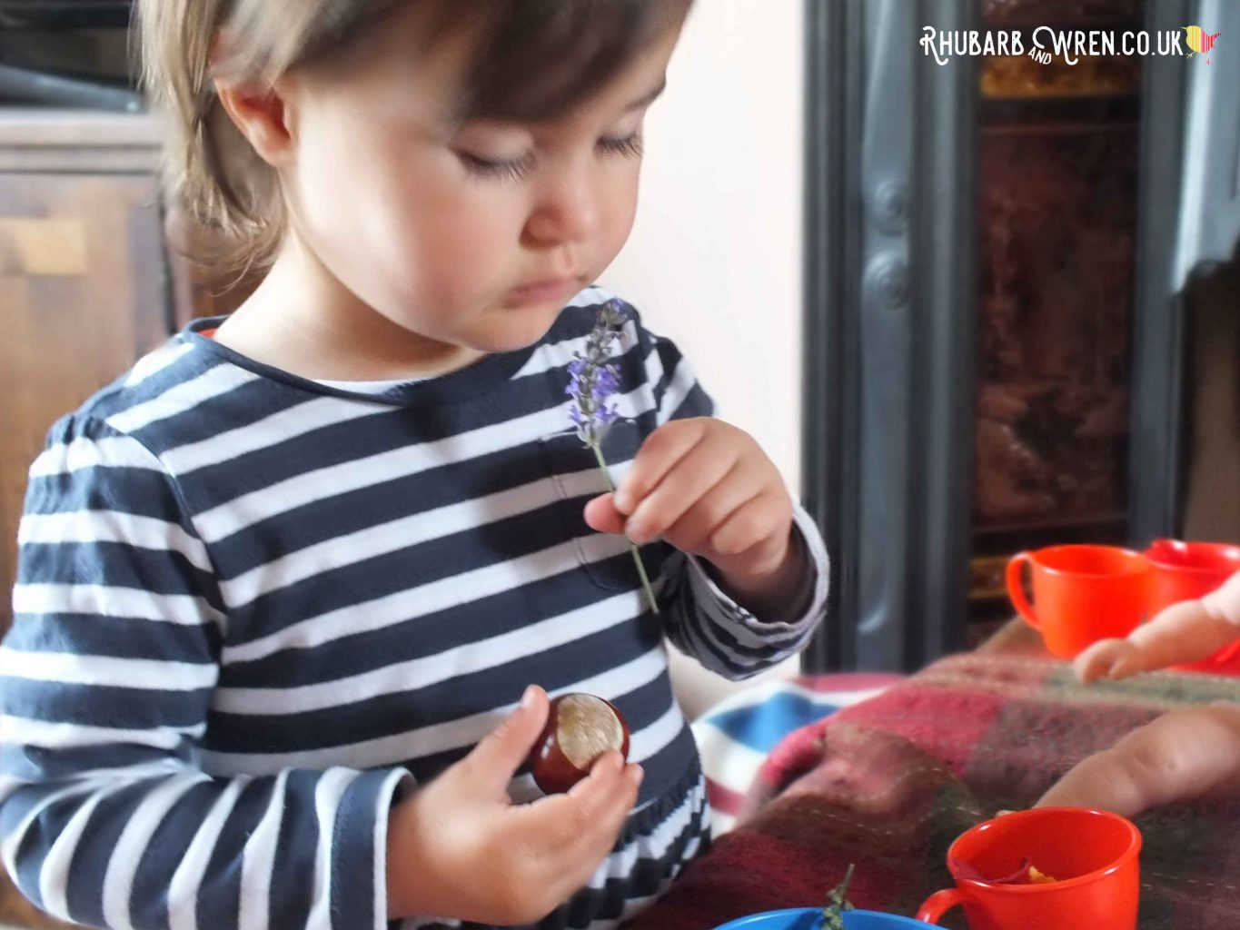 Toddler smelling lavender with eyes closed
