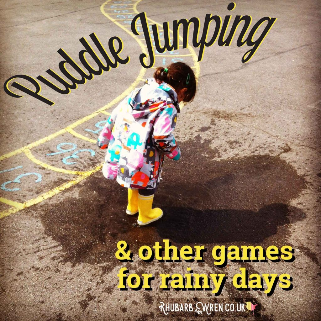 child jumping in puddles