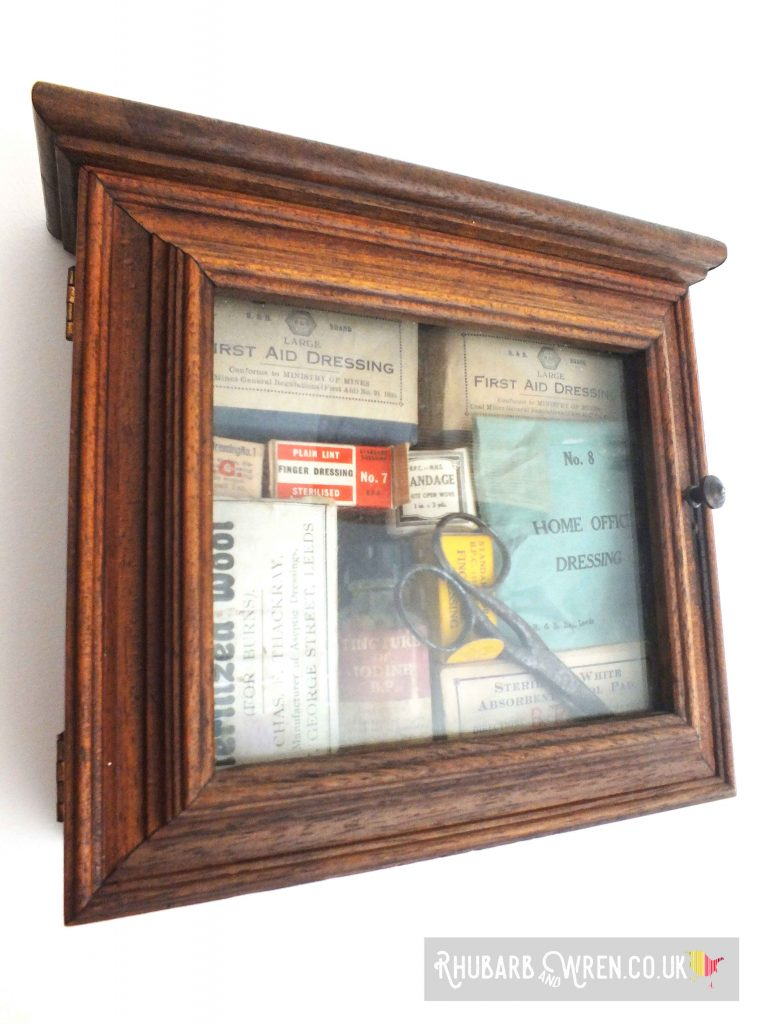 Vintage supplies displayed in a key cabinet.