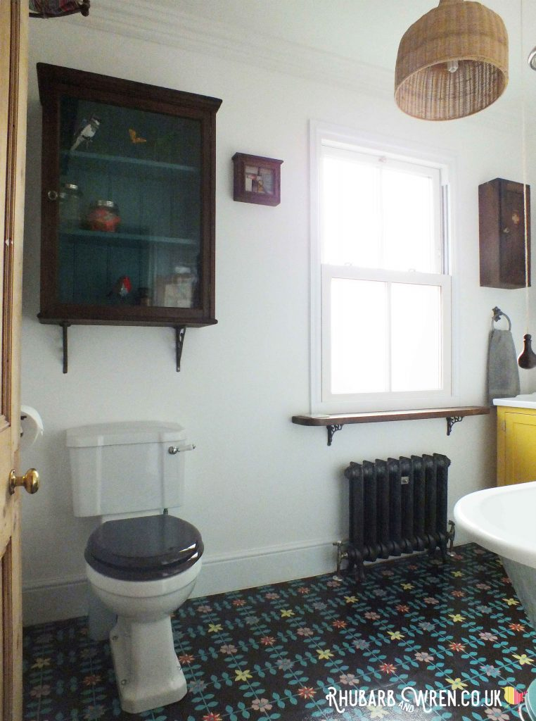 bathroom with floral vinyl tiles