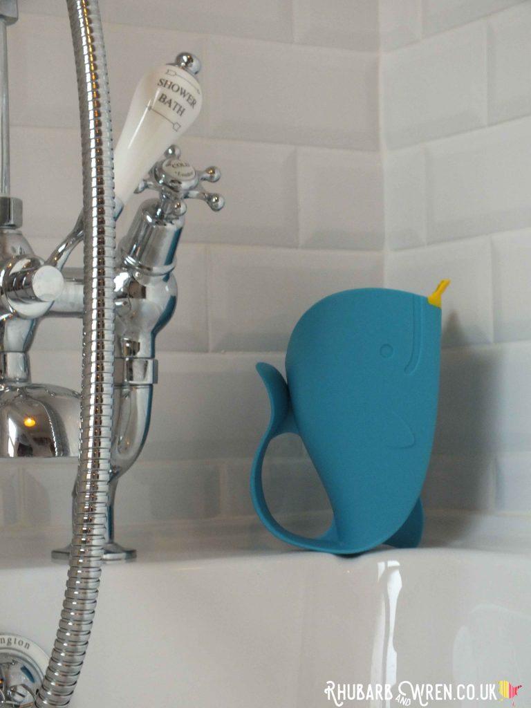 Skip Hop whale jug on side of bath