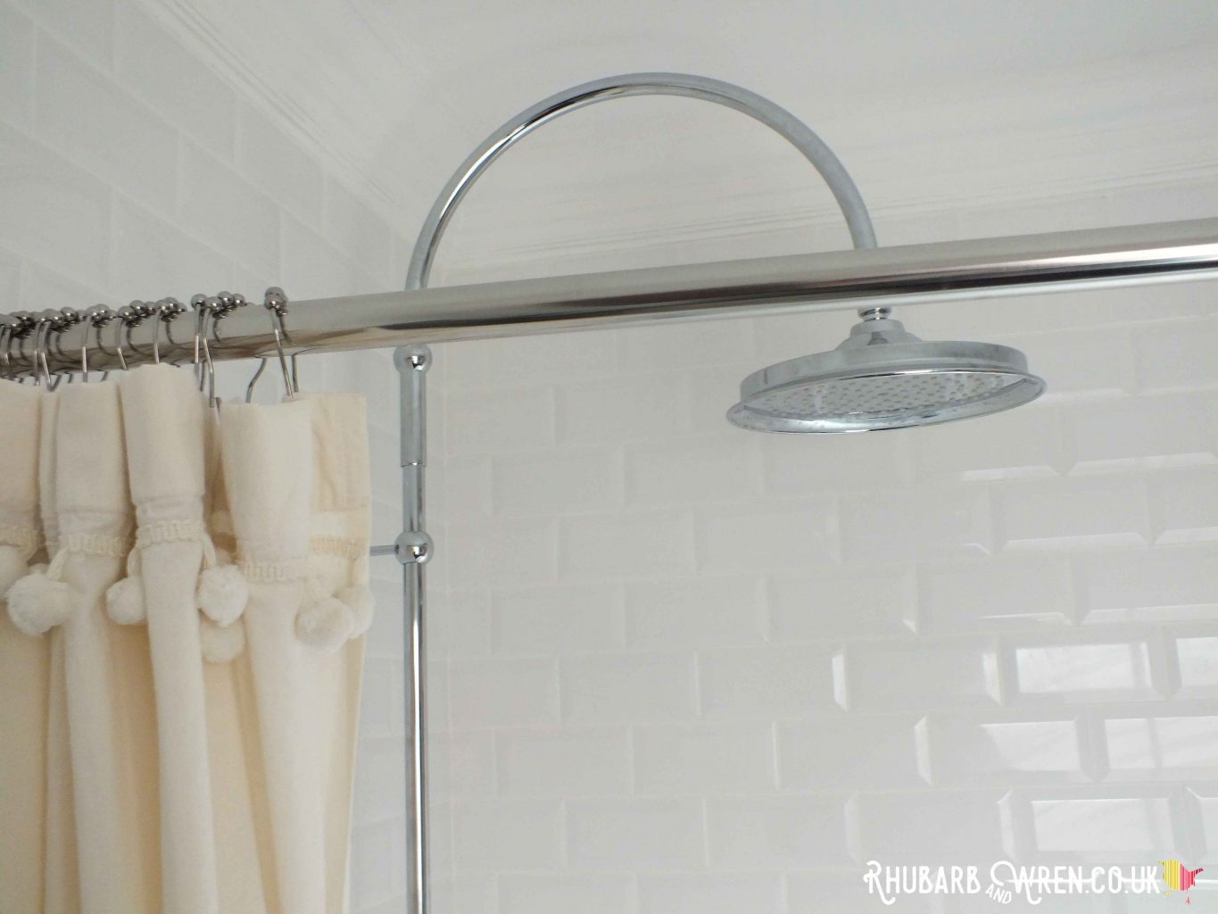 Cotton shower curtain with pompom decorations, and rainfall shower