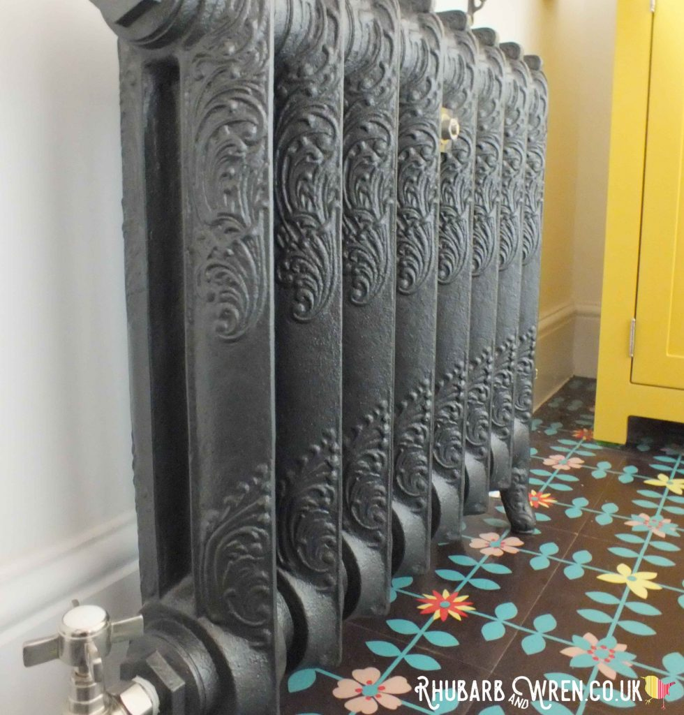 A vintage-style ornate cast iron 'Rococo' radiator