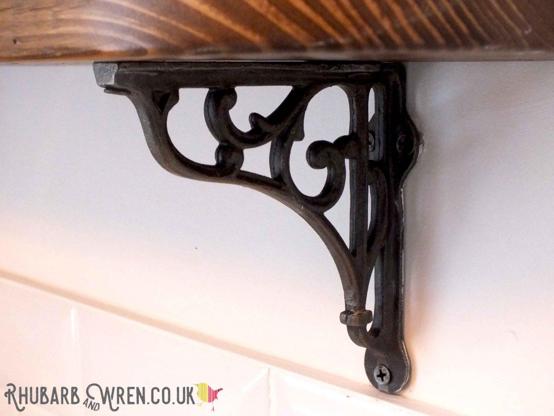 Ornate cast iron brackets