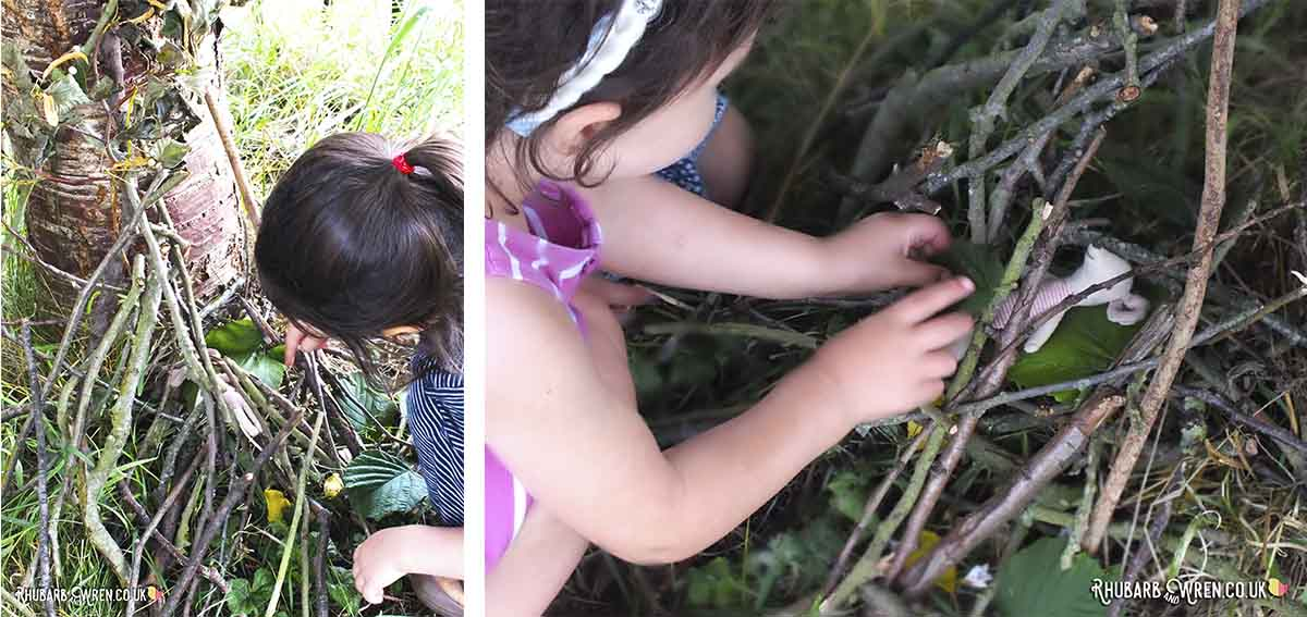 children building mini dens made of twigs for toy mouse