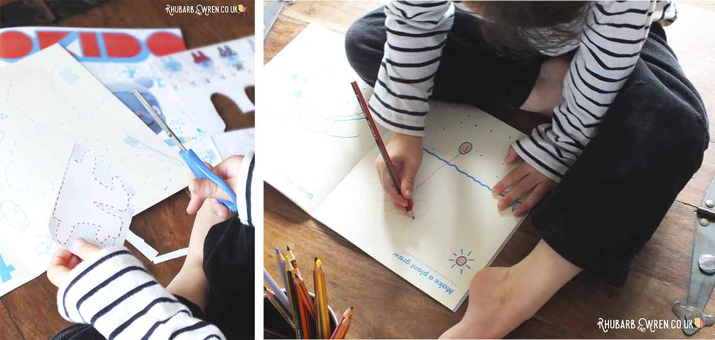 Child doing cutting out and drawing activities in Okido magazine