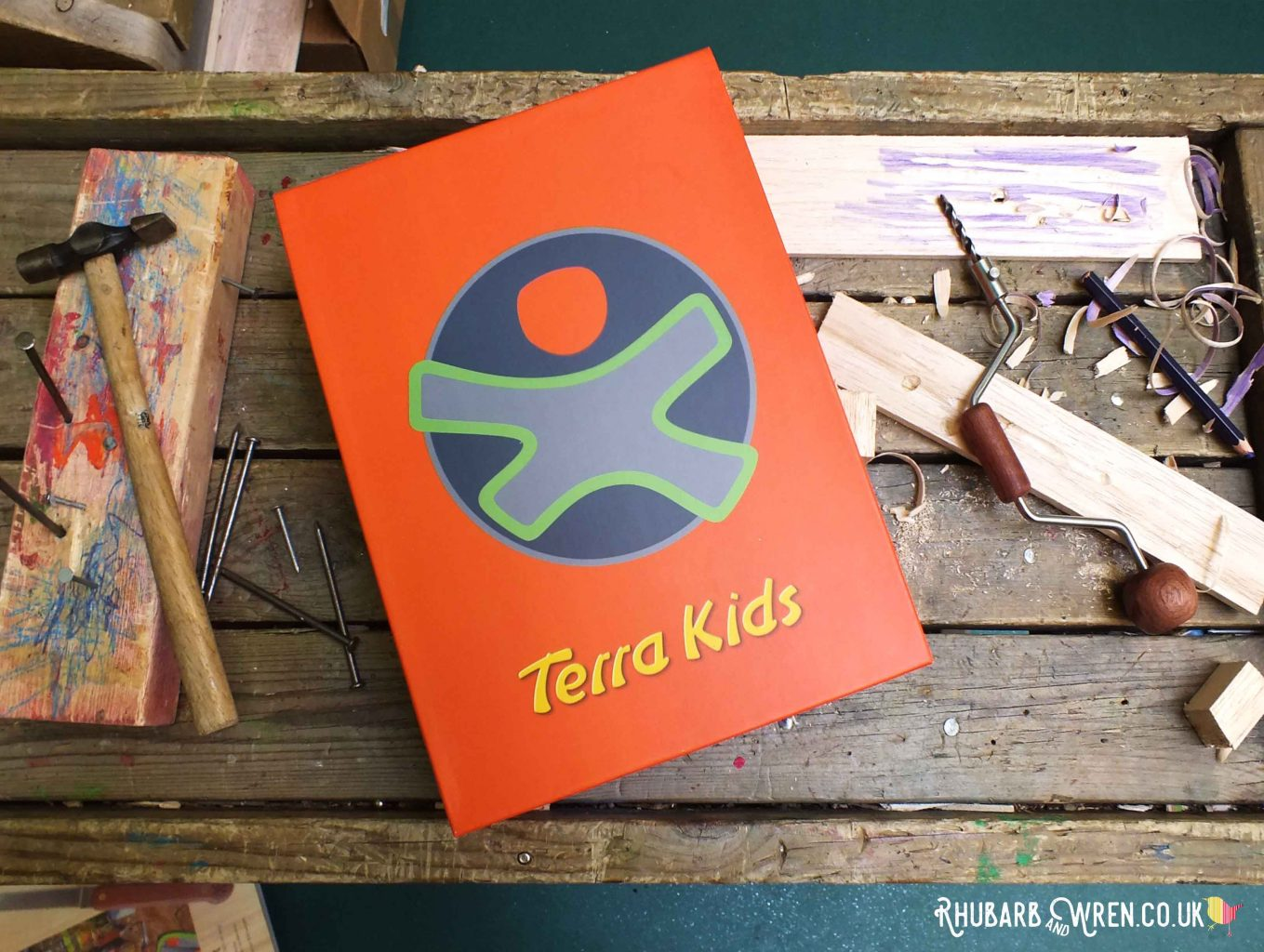 Box of HABA's Terra Kids tools on workbench