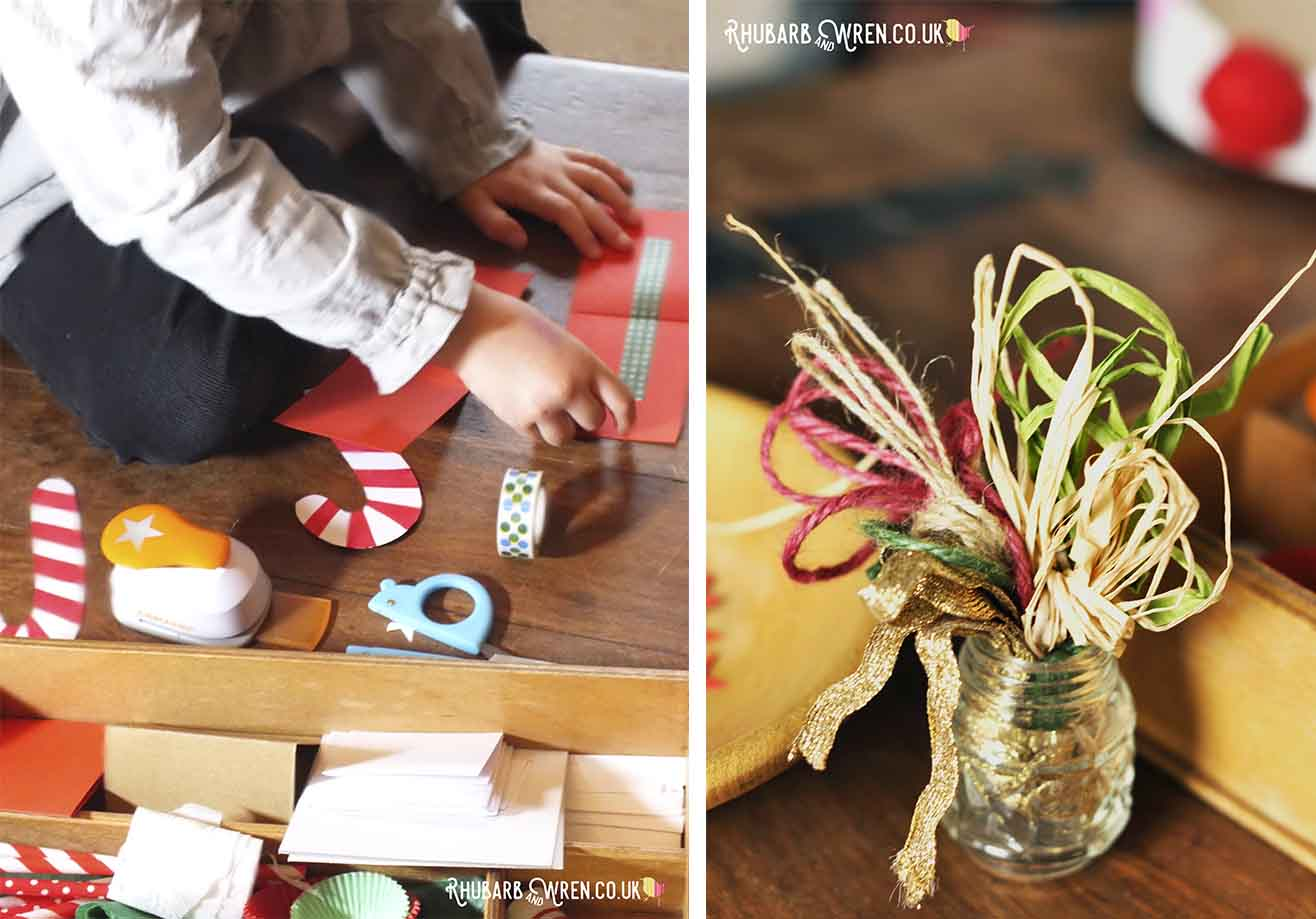 child sticking washi tape and jar of coloured string