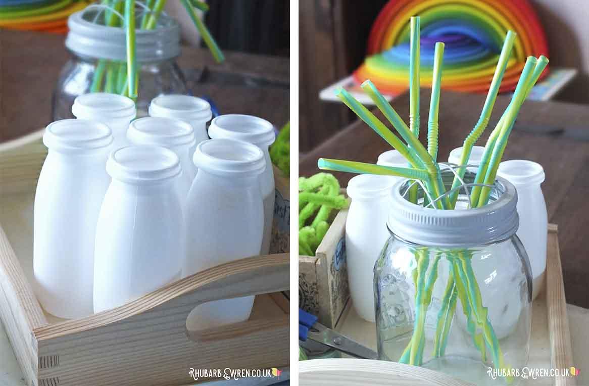 Empty plastic yoghurt drink bottles and bendy straws