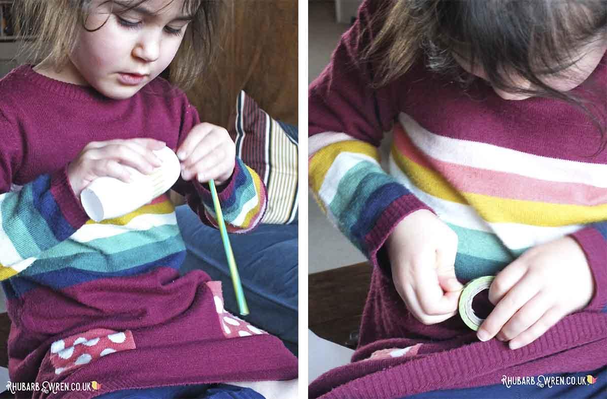 Child making bottle flower and using washi tape
