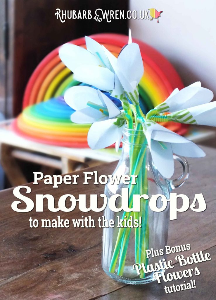 DIY paper snowdrops arranged in a bottle vase