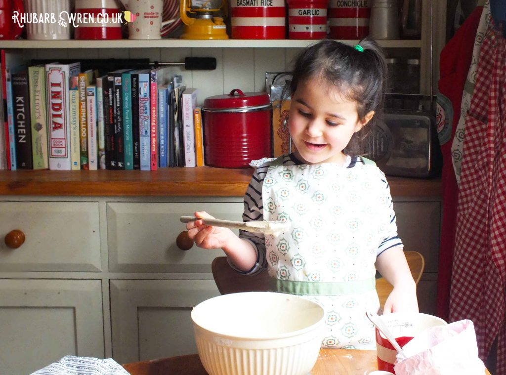 Children love mixing up pancake batter.