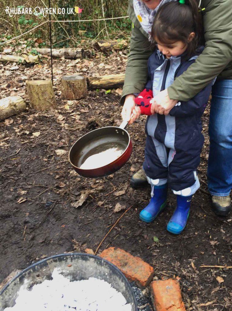 Flipping campfire pancakes