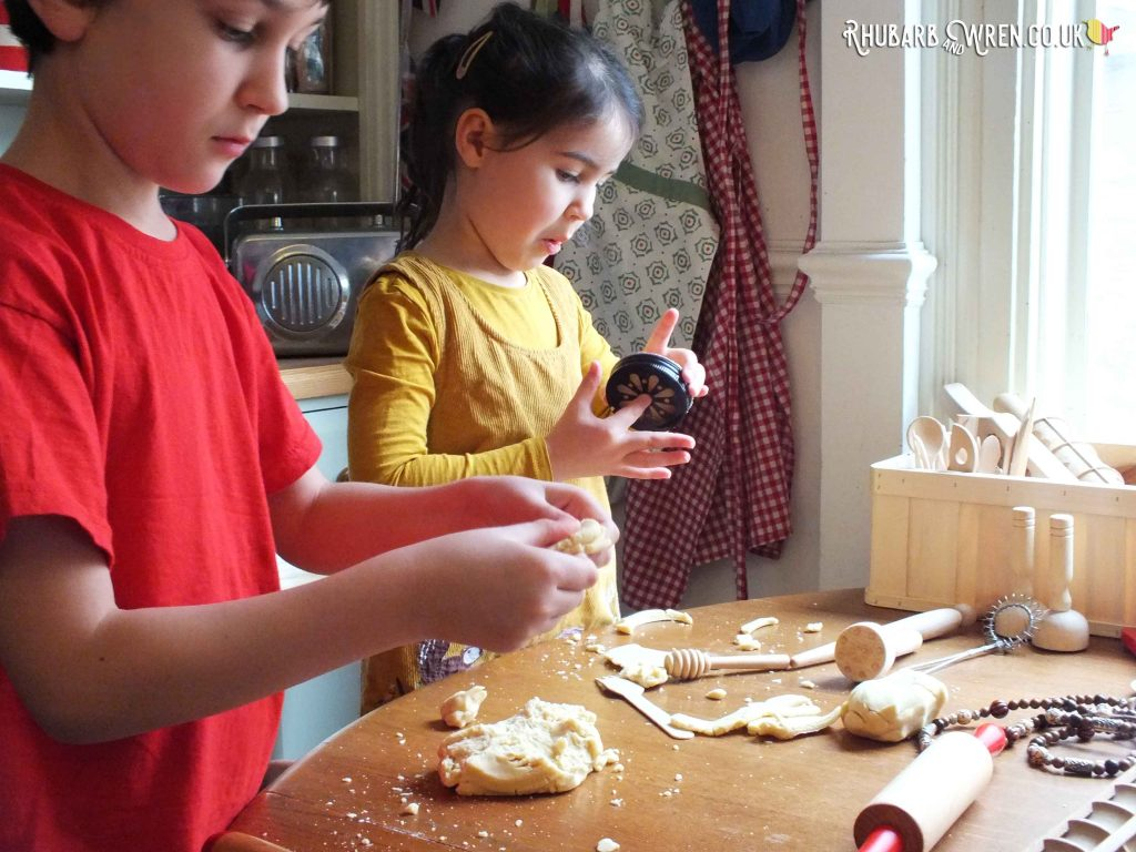 Kids playing with home-made play dough and wooden tools