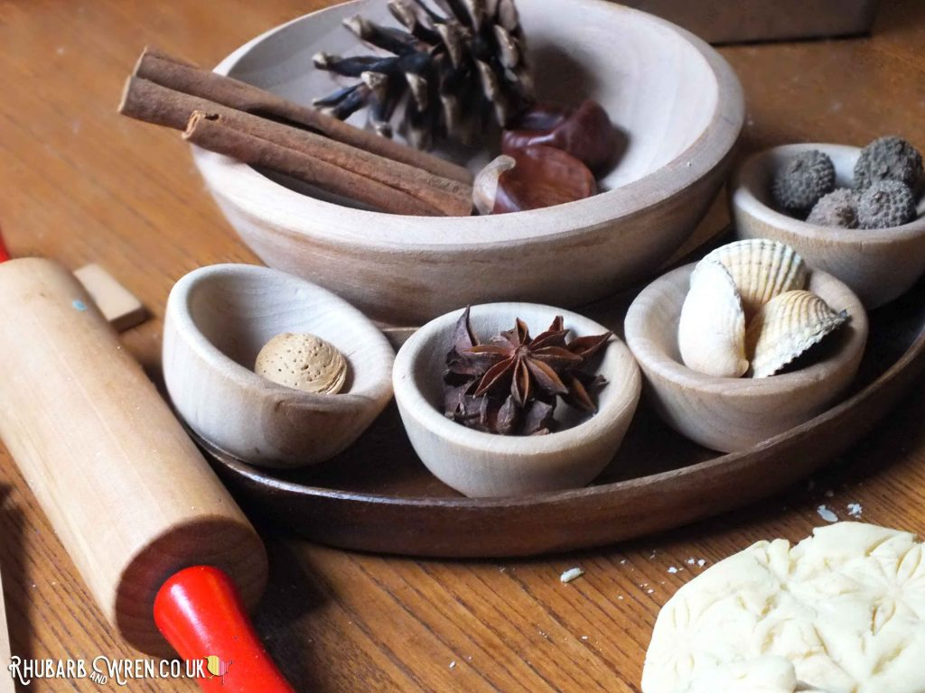 Natural materials - pinecones, cinnamon sticks, shells, acorns, star anise.