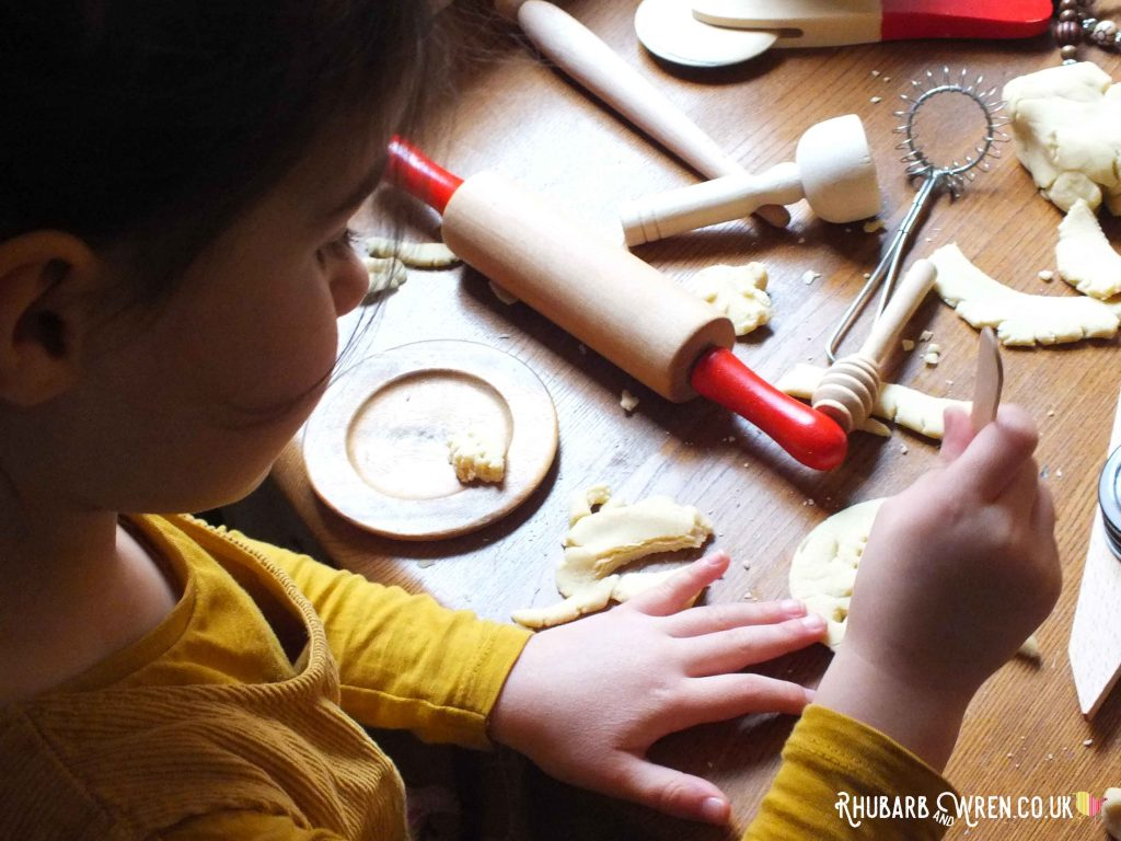 A pile of different tools for rolling, stamping and shaping play dough