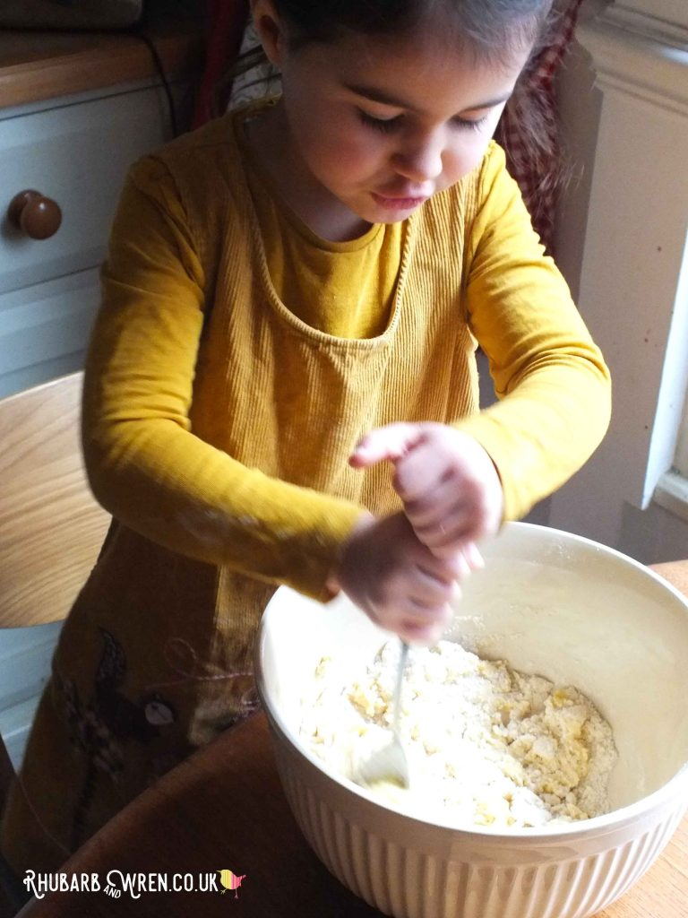 Girl stirring sticky mixture in bowl