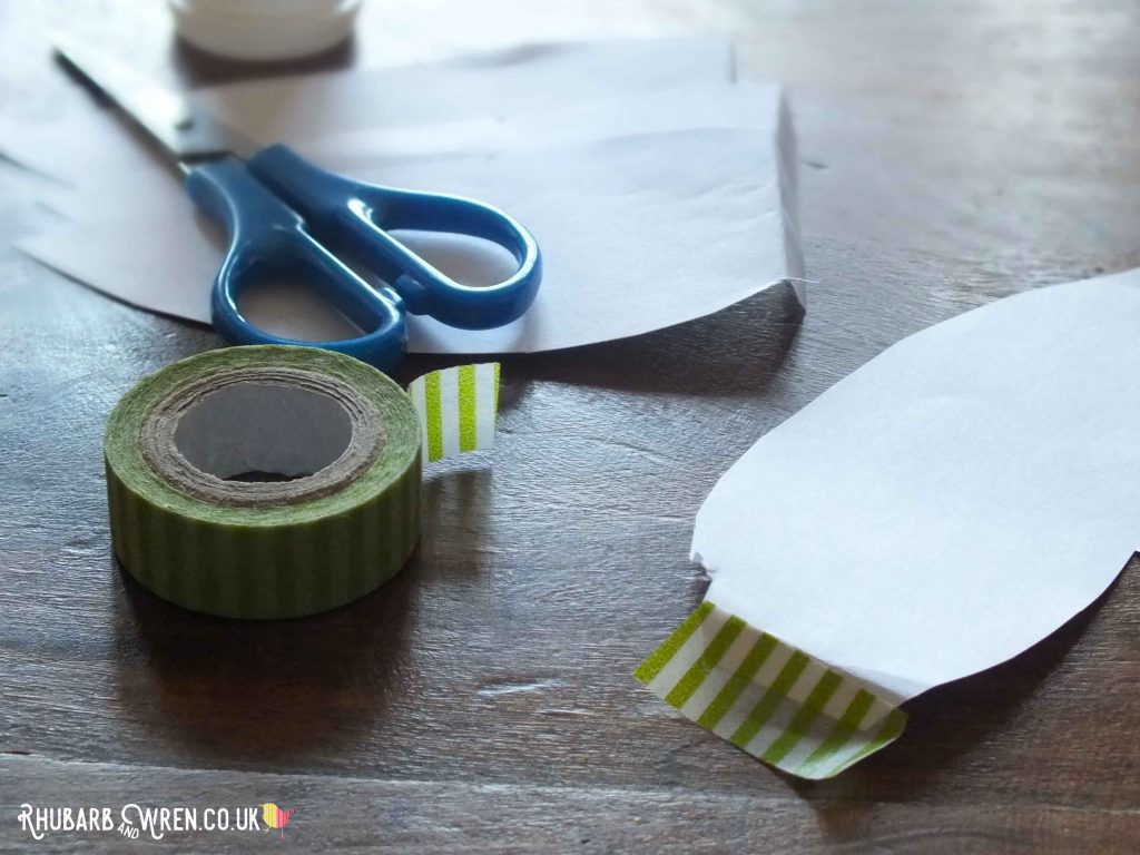 cut-out paper petal with washi tape attached.