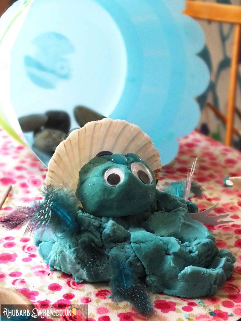 Home-made play dough bog baby inside clam shell