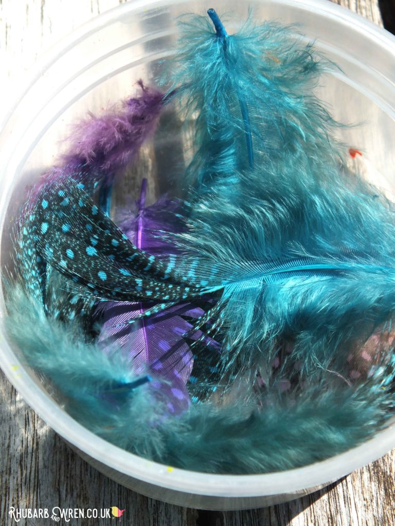 bowl of bright blue feathers