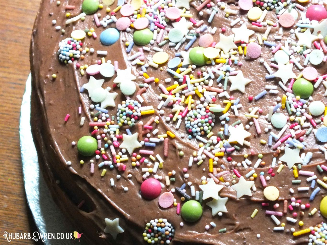 Close-up of chocolate cake covered in colourful sprinkles