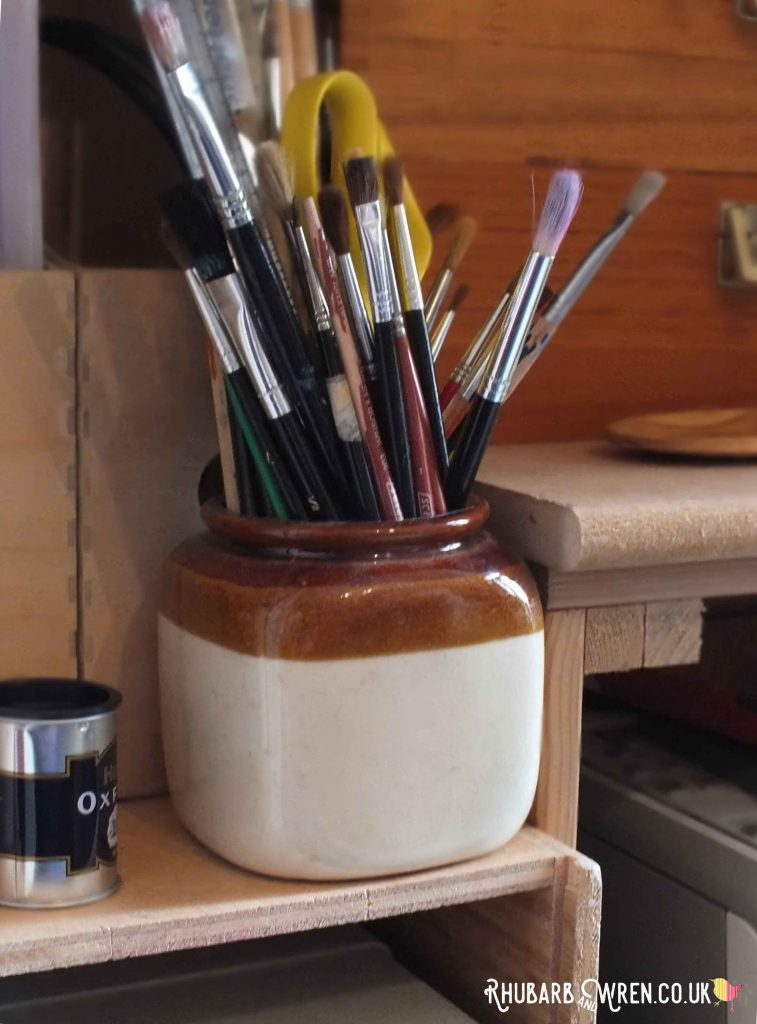 stoneware jar of artists paintbrushes
