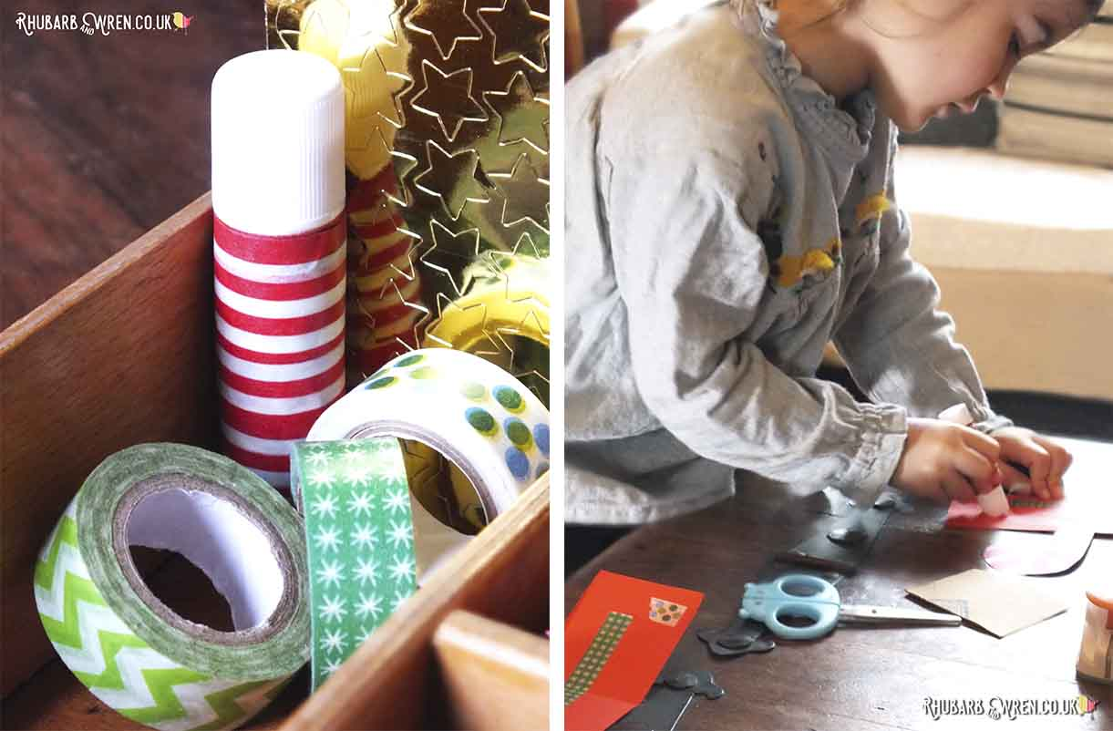 child using glue stick and washi tape on coloured card
