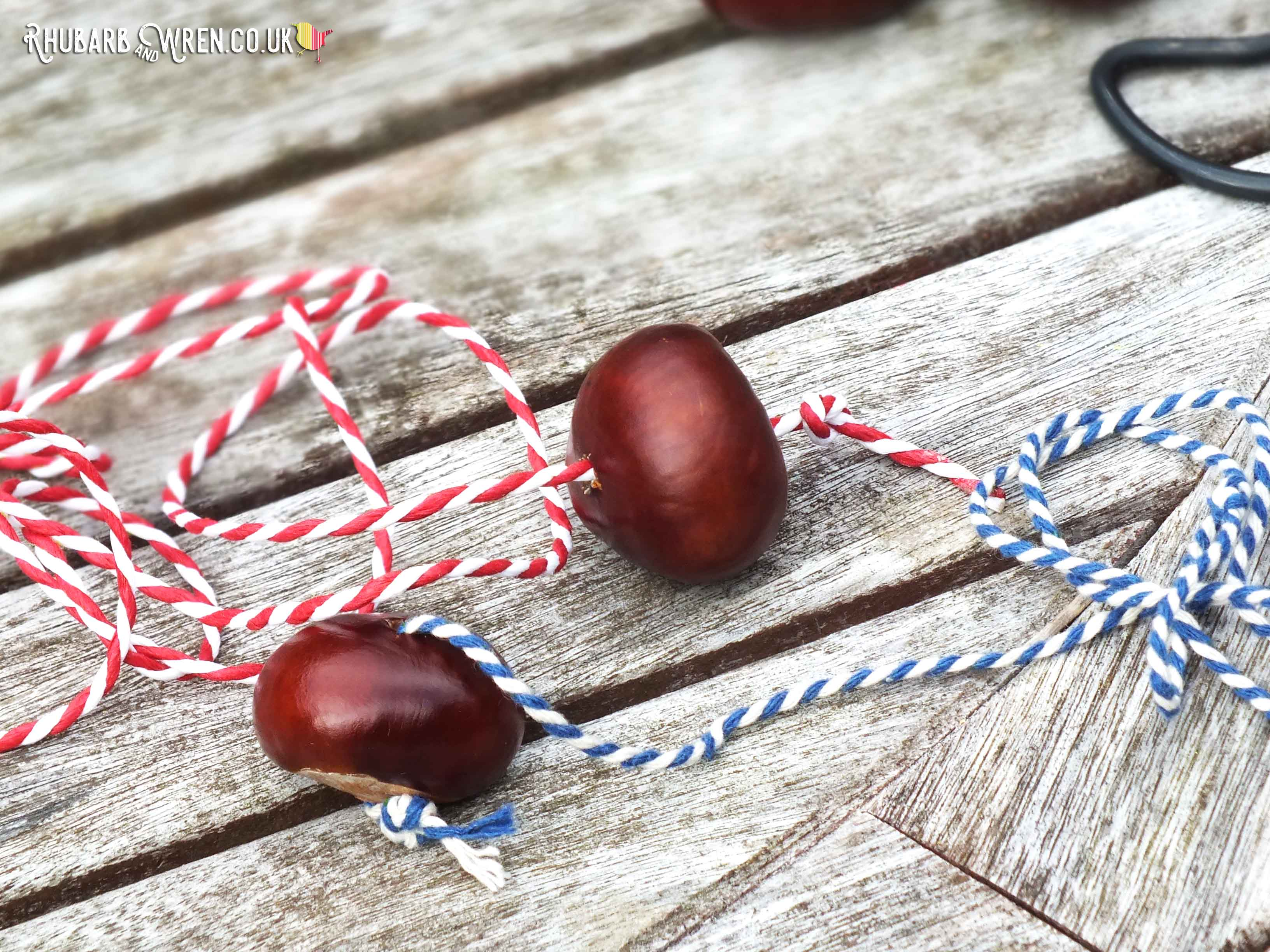 Conkers threaded onto striped bakers twine or butchers string