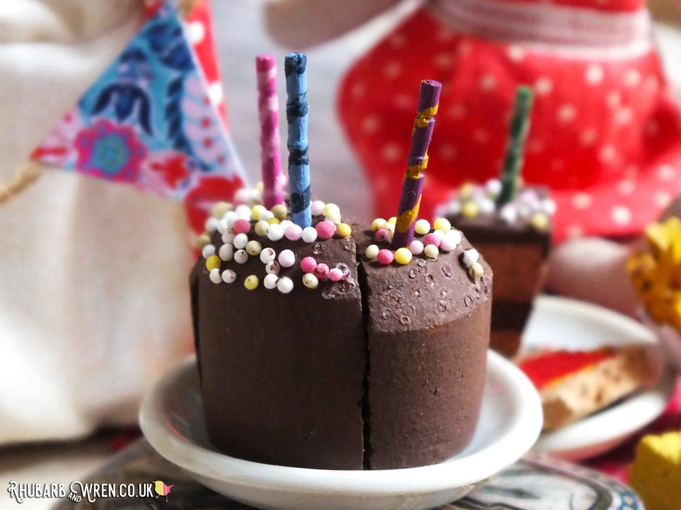 Homemade doll food chocolate cake with birthday candles