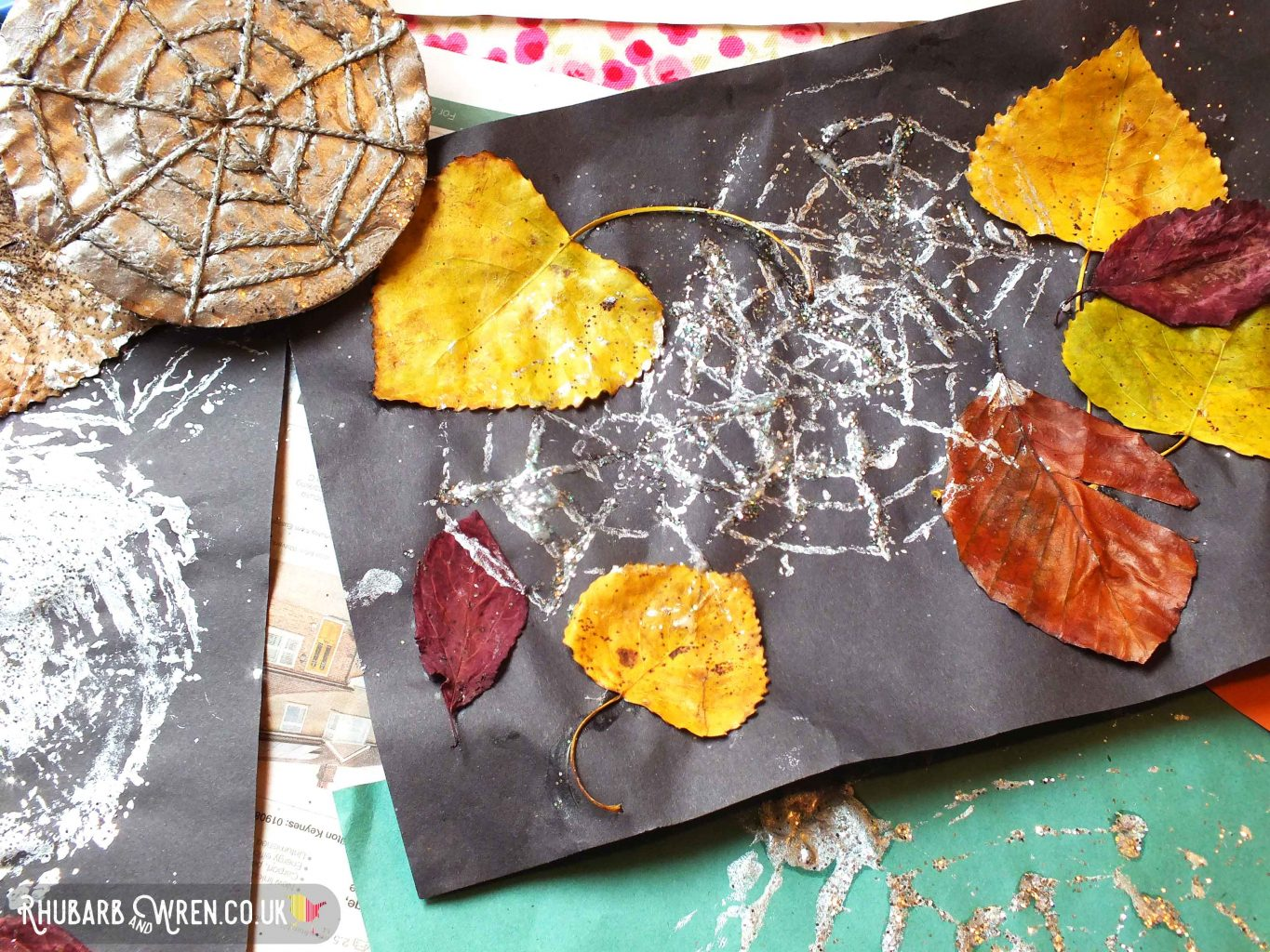 leaf collage printed with silver webs using a DIY spiderweb stampers