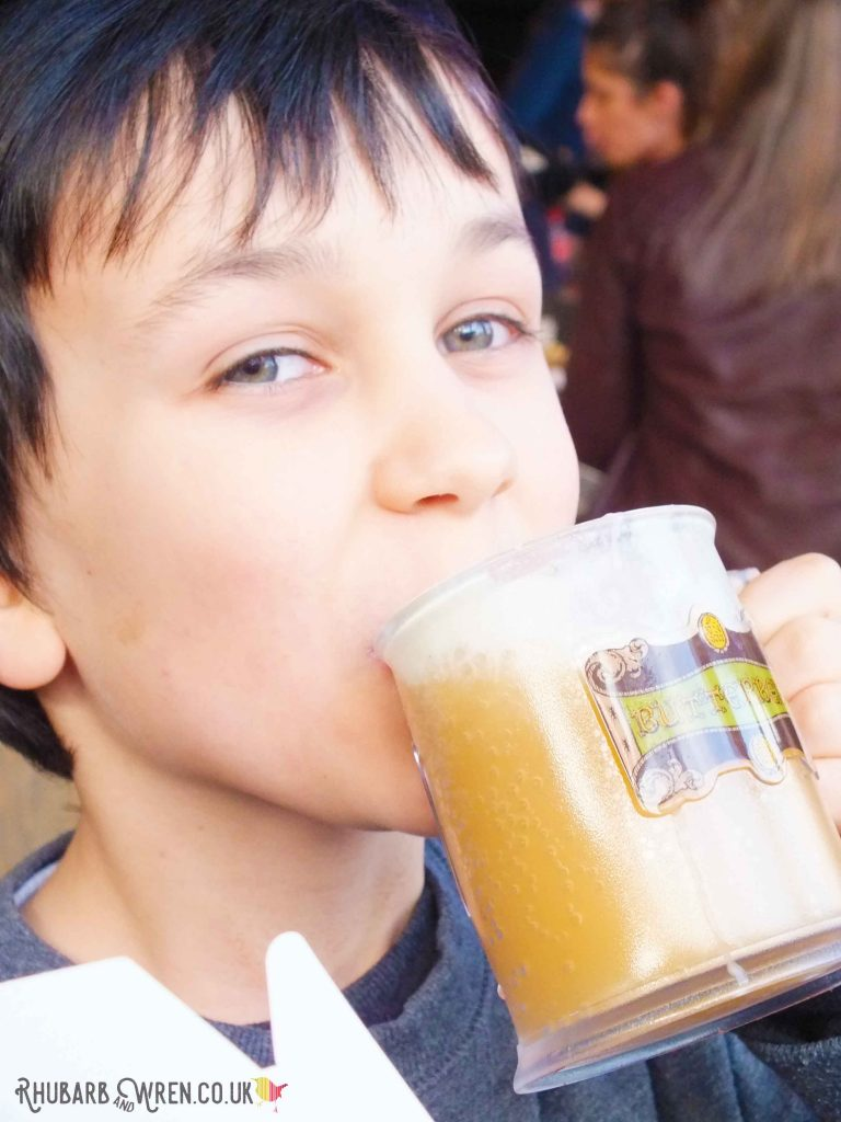 boy drinking stein of butterbeer at the Harry Potter studio tour
