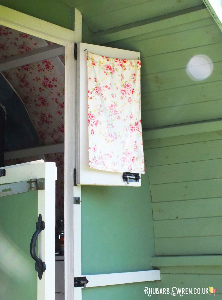 Gypsy caravan open door with floral curtains