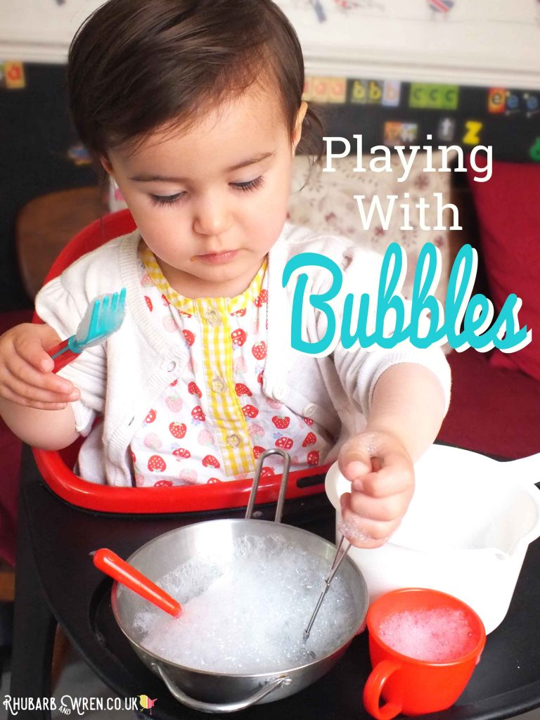 toddler playing with bubbles for messy play