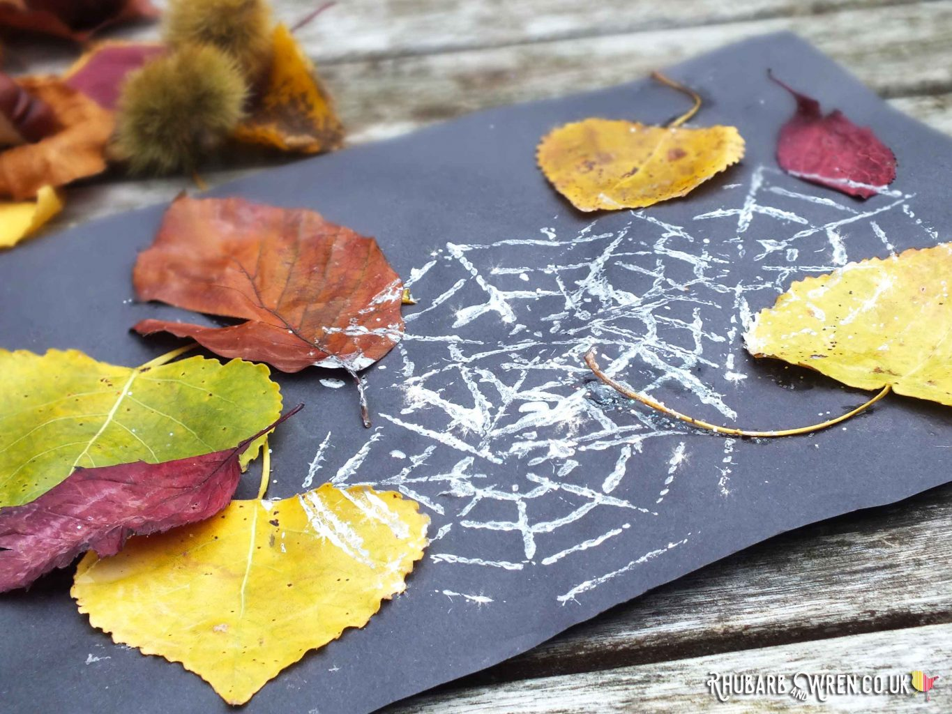 Collage on black paper - real autumn leaves stamped with glittery silver spiderwebs