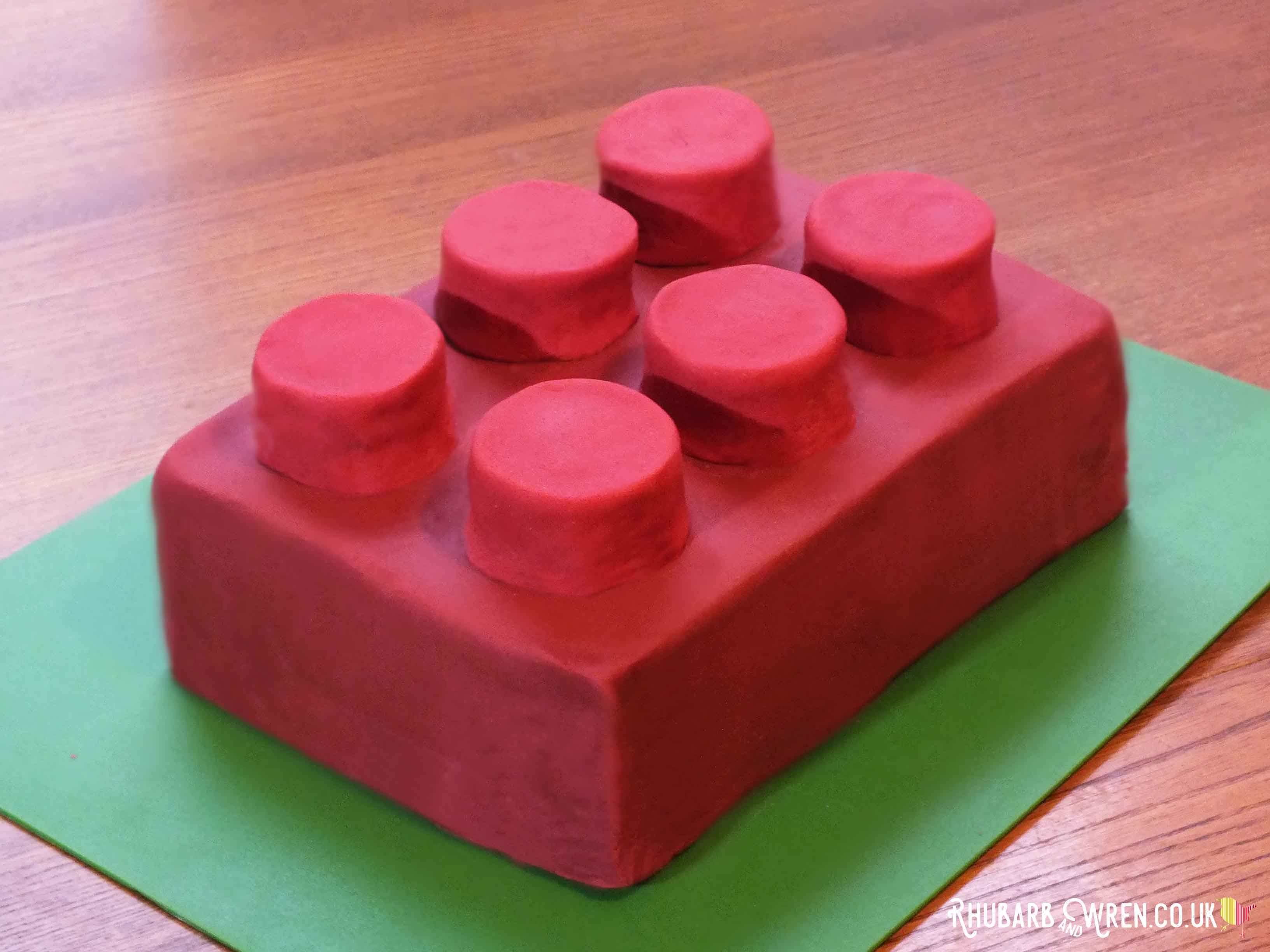 Giant Lego brick cake covered with red fondant icing.