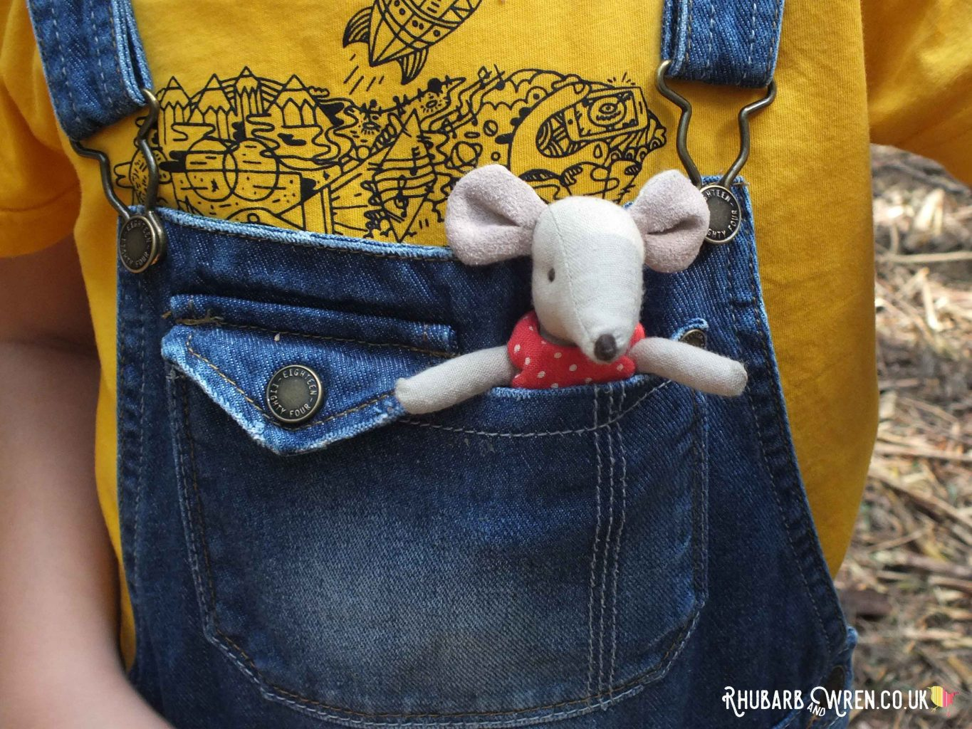 Maileg mouse toy in child's jeans dungaree pocket