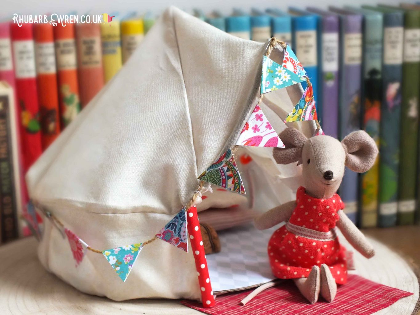 Maileg mouse sitting outside toy bell tent
