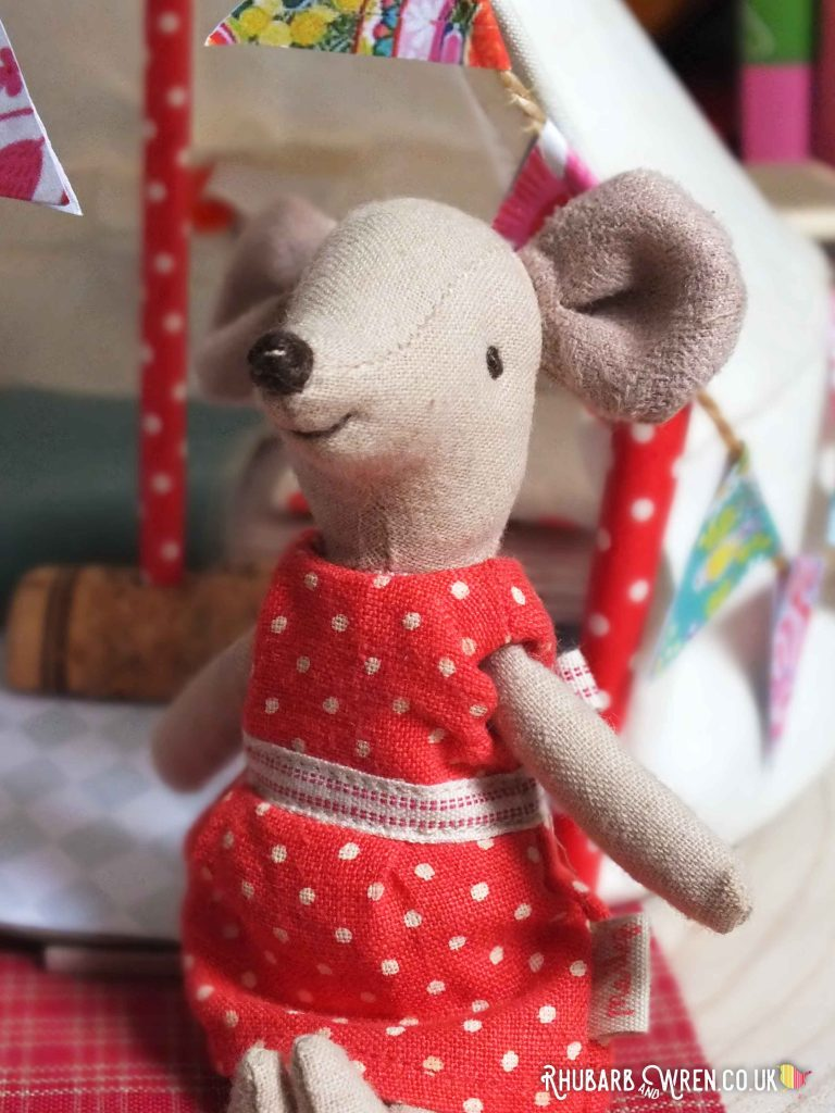 Close up of Maileg mouse Big Sister wearing red polka dot dress