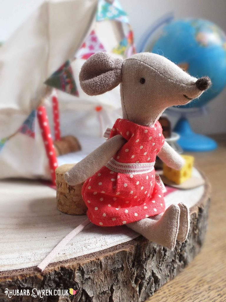 Close up of Maileg mouse Big Sister in front of toy bell tent