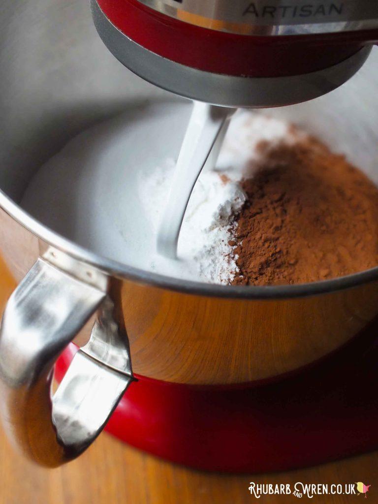 KitchenAid mixer bowl with mix of sugar and flour