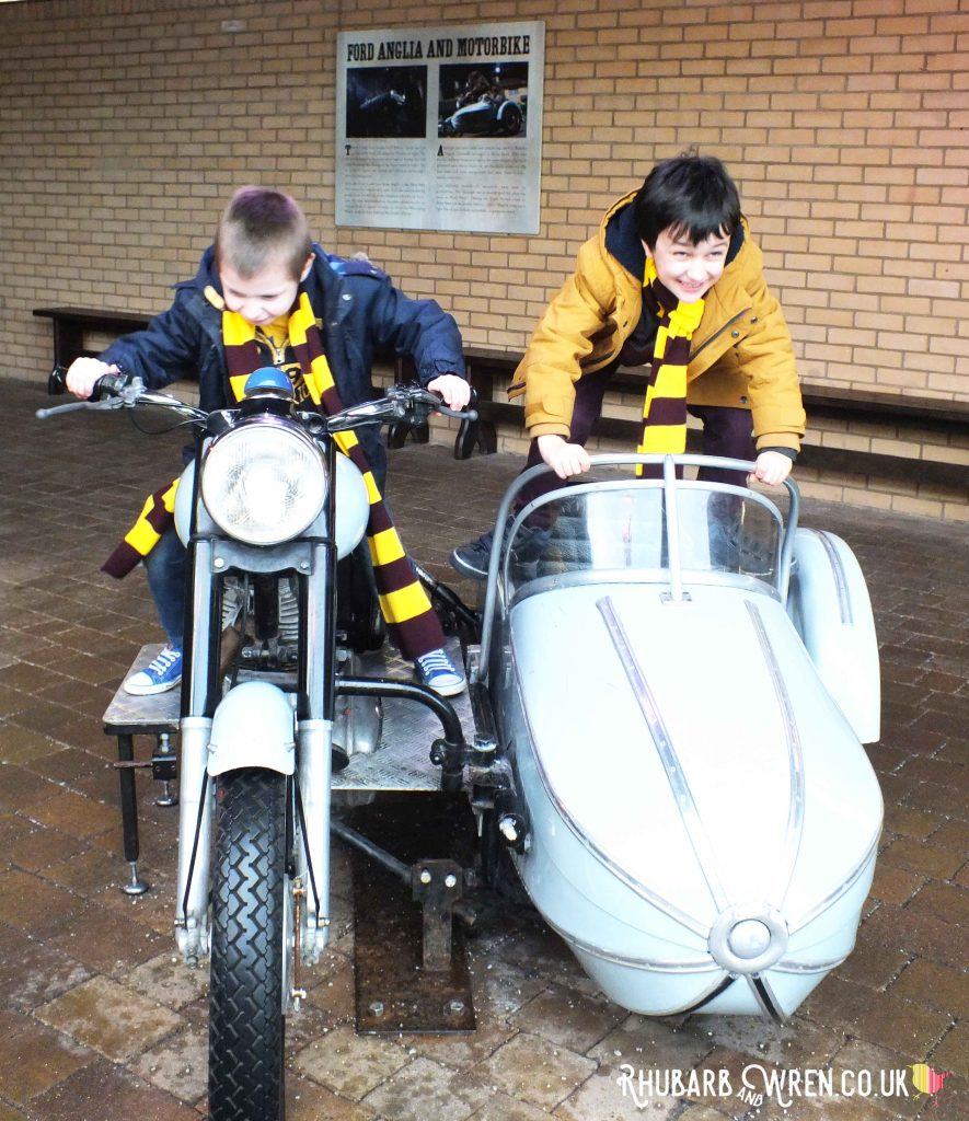 Kids playing on Hagrid's flying motorbike at the Harry Potter studio tour