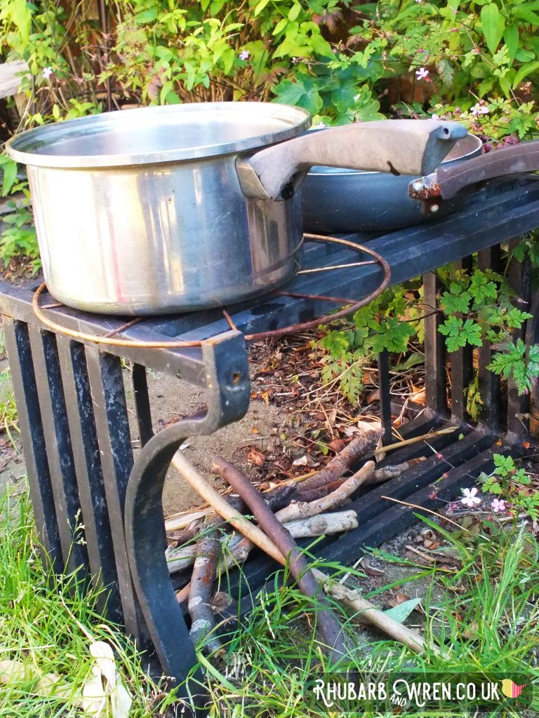 Mud kitchen made from upturned fire grate