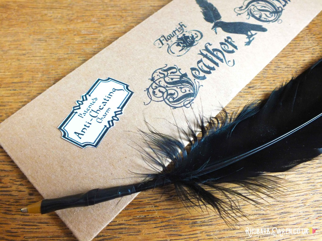 Anti-cheating charm label on a black feather quill packet for a DIY Harry Potter party bag