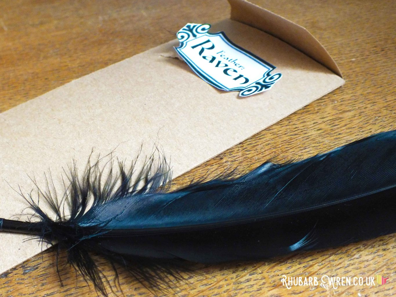 Black feather quill with 'Raven' label for a DIY Harry Potter party bag