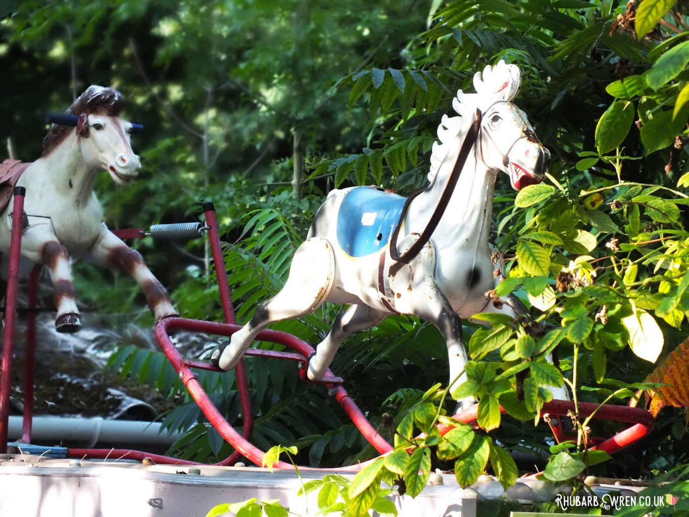 Vintage rocking horse on roof of cafe at Farrs Meadow campsite, Dorset, UK