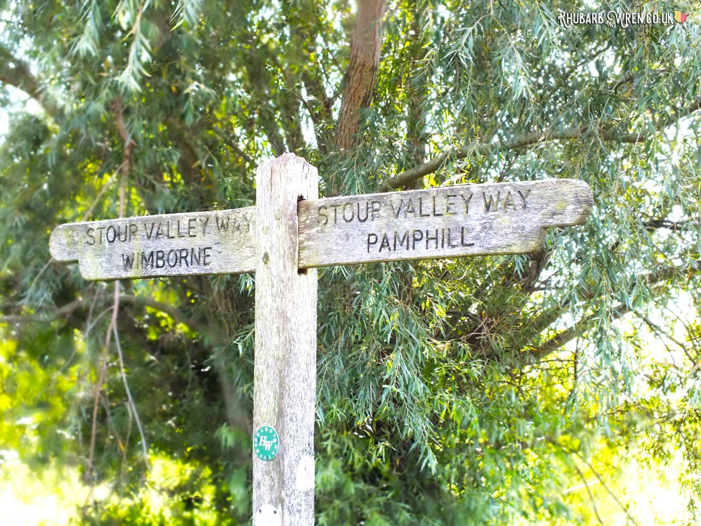 Rustic wooden signpost pointing to Stour Valley, Wimbourne and Pamphill, Dorset, UK