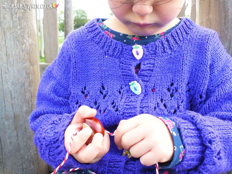 girl threading conker onto string
